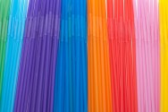 Groups of drinking straws sorted by colors